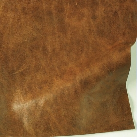 Milled grain bovine leather